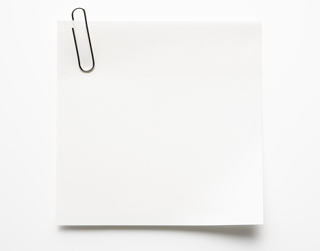 Blank white sticky note and paper clip isolated on white background with clipping path.