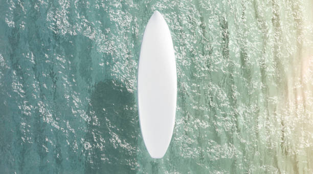 Blank white surfboard on water surface mockup, top view stock photo