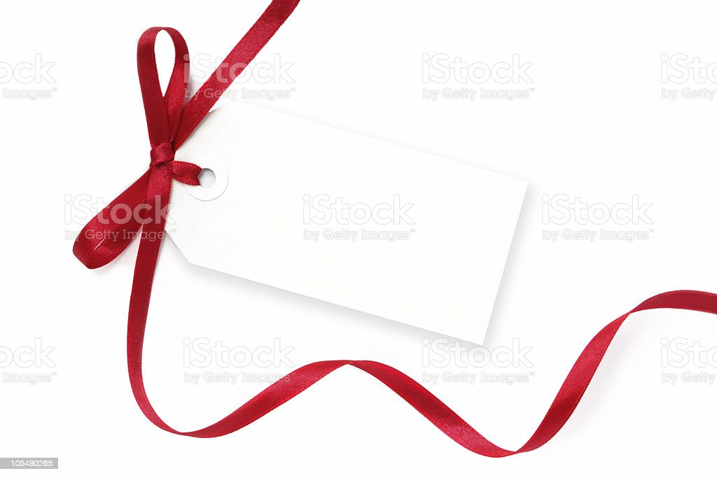 A blank, white tag with a flowing red ribbon tied on it stock photo