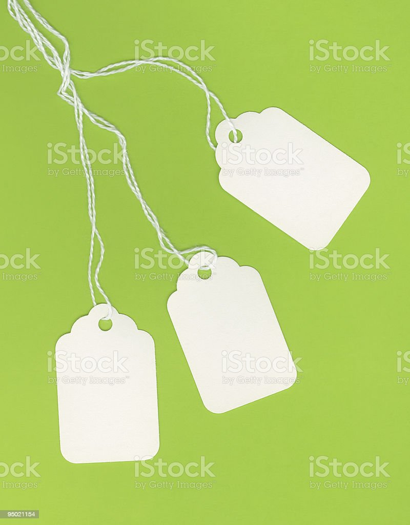 Blank White Tags on Green Background royalty-free stock photo