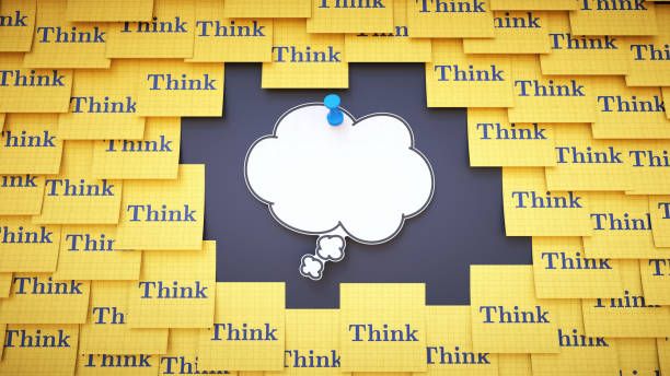 """A blank white thought bubble, surrounded by many sticky notes with the word """"Think"""". stock photo"""