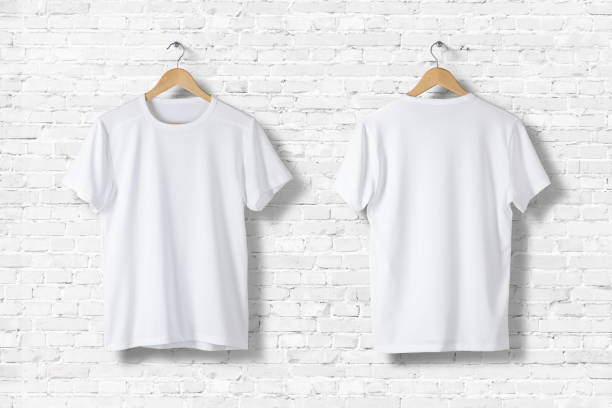 blank white t-shirts mock-up hanging on white wall, front and rear side view . ready to replace your design - t shirt stock photos and pictures