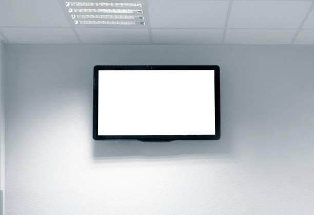 Écran blanc blanc blanc de tv sur le mur - Photo
