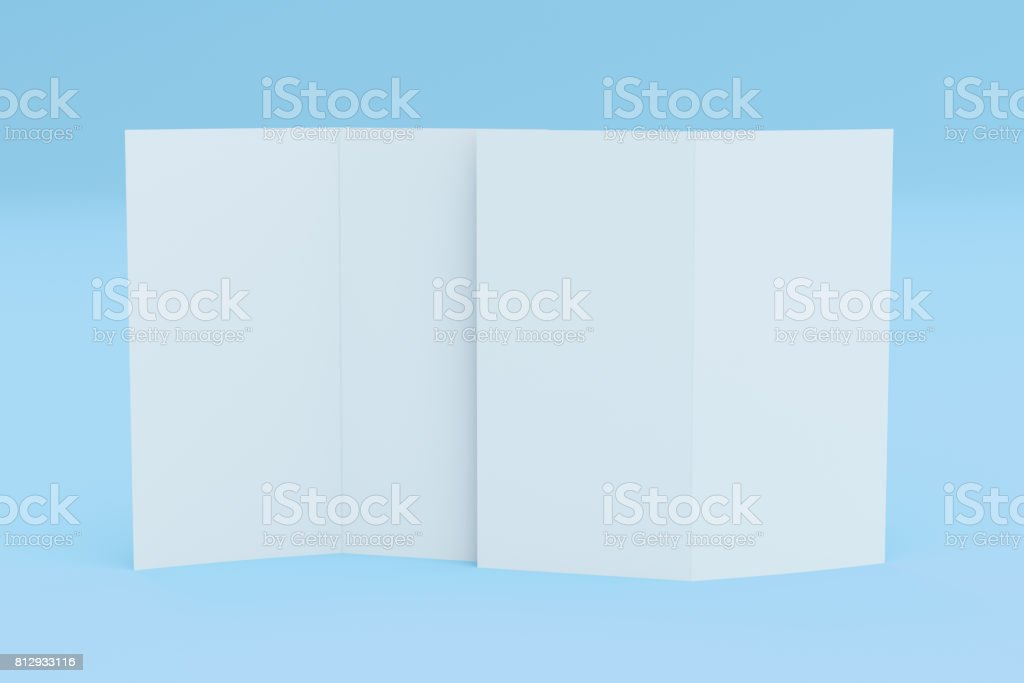 blank white two fold brochure mockup on blue background stock photo