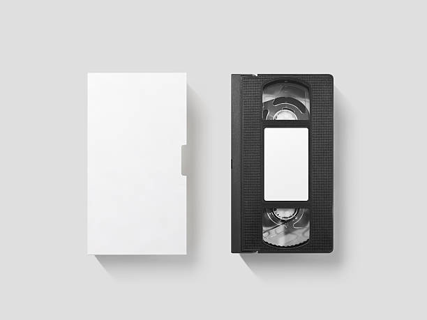 Blank white video cassette tape mockup, top view, clipping path Blank white video cassette tape mockup, isolated, top view, clipping path. Clear vhs cassete case design mock up. Retro tv videotape cover template. Analog movie casette box copy with sticker audio cassette stock pictures, royalty-free photos & images