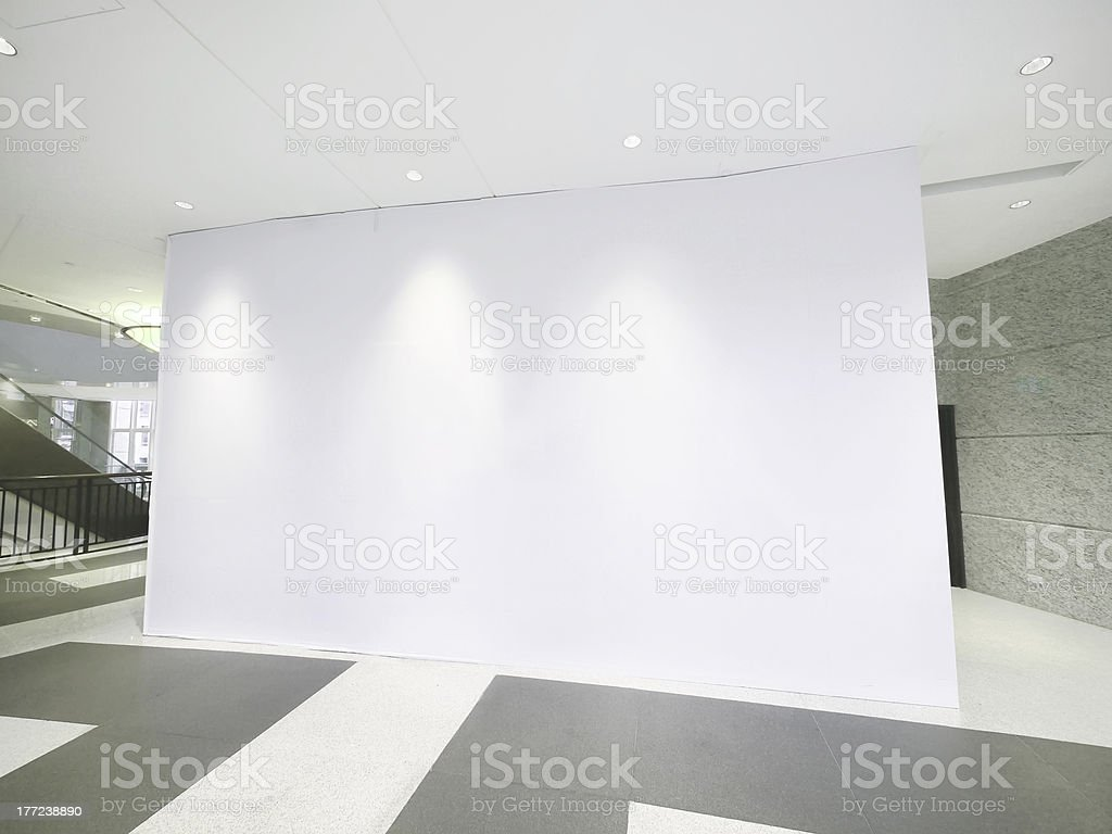 Blank white wall inside a large modern building royalty-free stock photo