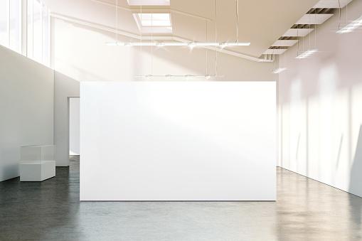 Blank white wall mockup in sunny modern empty museum