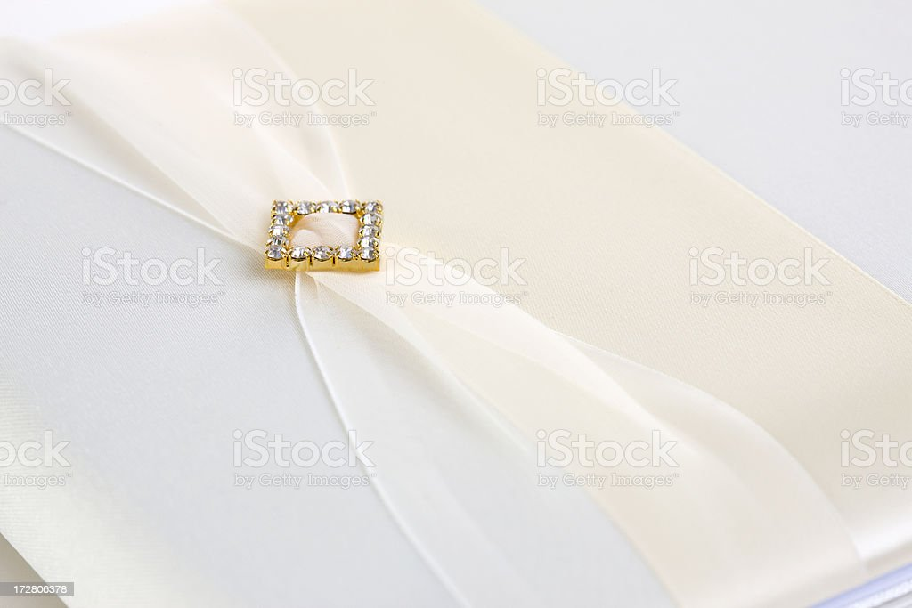 Blank White Wedding Guest Book Cover with Creme Ribbon, Copyspace royalty-free stock photo