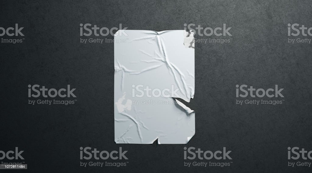 Blank white wheatpaste adhesive torn poster mockup black textured wall - Royalty-free A4 Paper Stock Photo