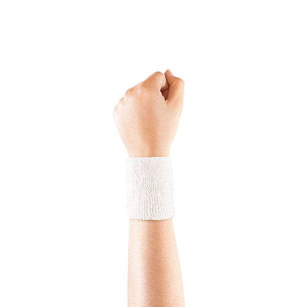 Blank white wristband mockup on hand, isolated Blank white wristband mockup on hand, isolated. Clear sweat band mock up design. Sport sweatband template wear on wrist arm. Sports support protective bandage wrap. Bangle on the tennis player hand. wristband stock pictures, royalty-free photos & images