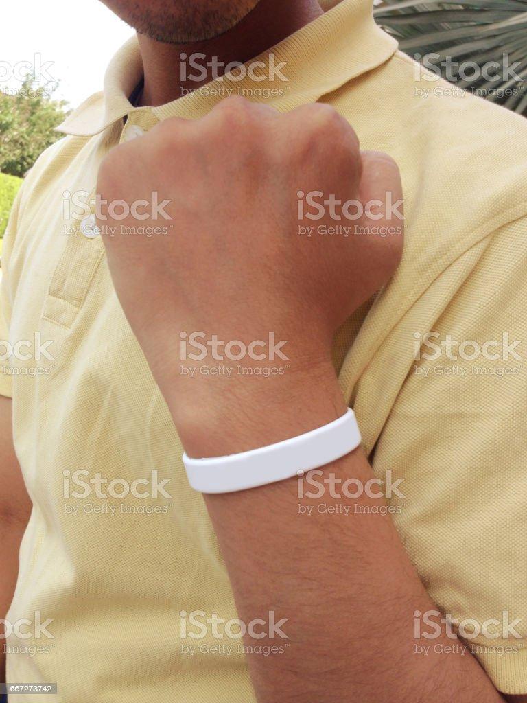Blank white wristband on hand stock photo