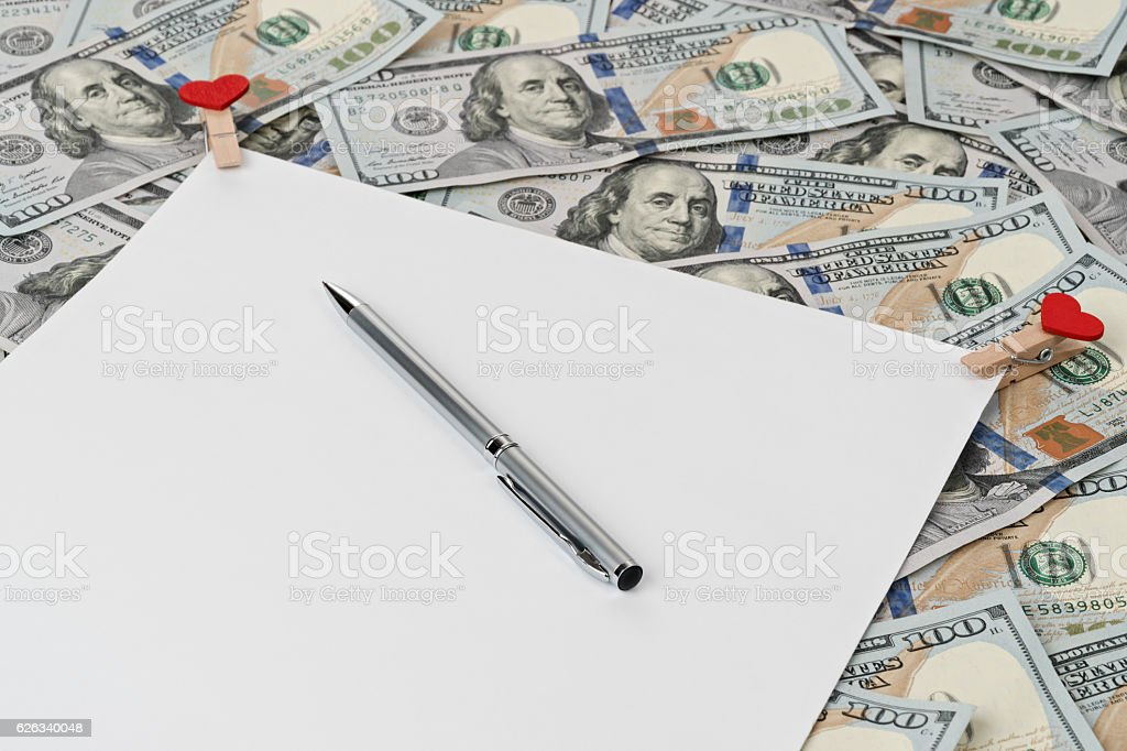 Blank with a pen on the money stock photo