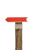 istock Blank wooden allow pointer red sign for background 620727330