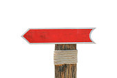 istock Blank wooden allow pointer red sign for background 620731594