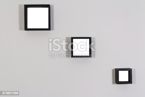 1141440440 istock photo Blank wooden frames template set on the inside wall 679857588
