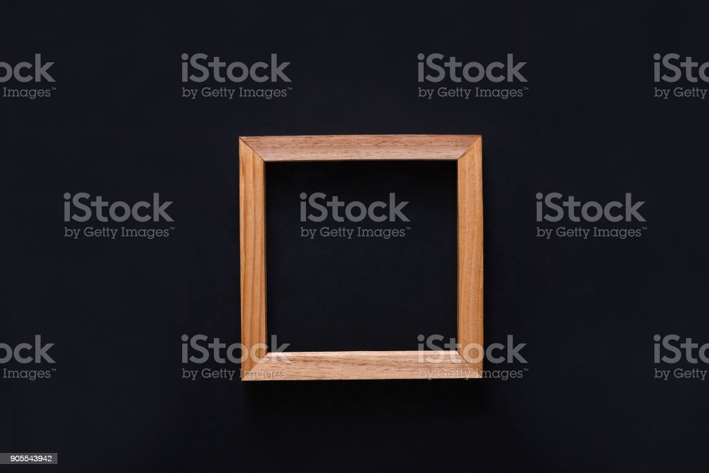 Blank wooden photo frame, cutout on black background stock photo