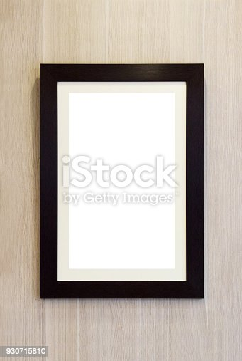 istock blank wooden photo frame on the wall 930715810