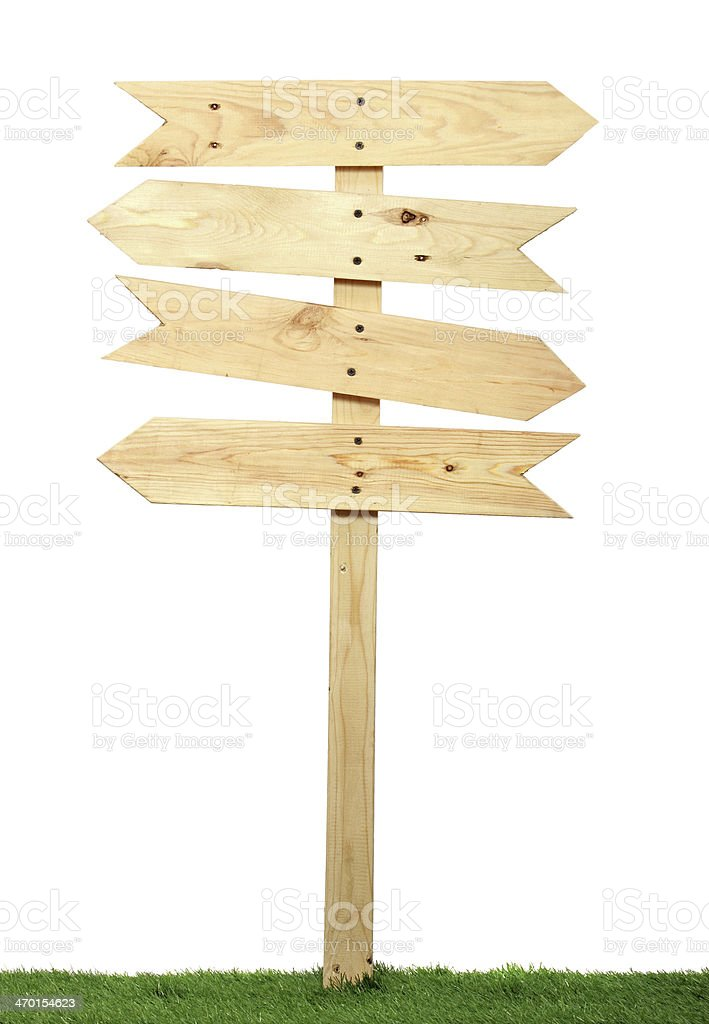 Blank wooden signs pointing in different directions stock photo