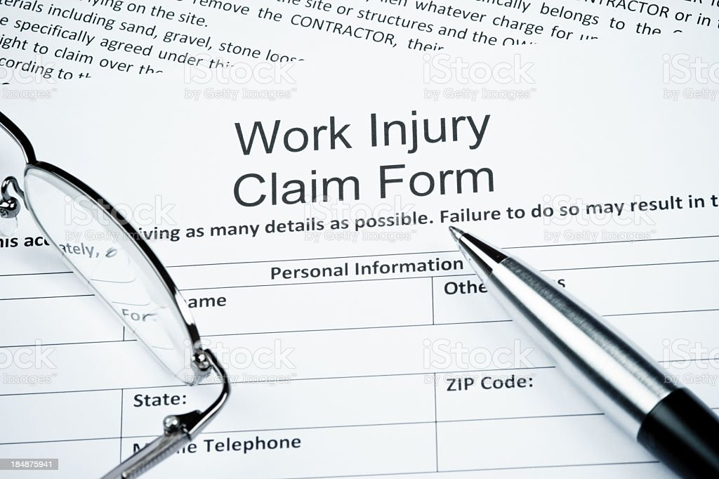 Blank work injury claim form with guidelines royalty-free stock photo