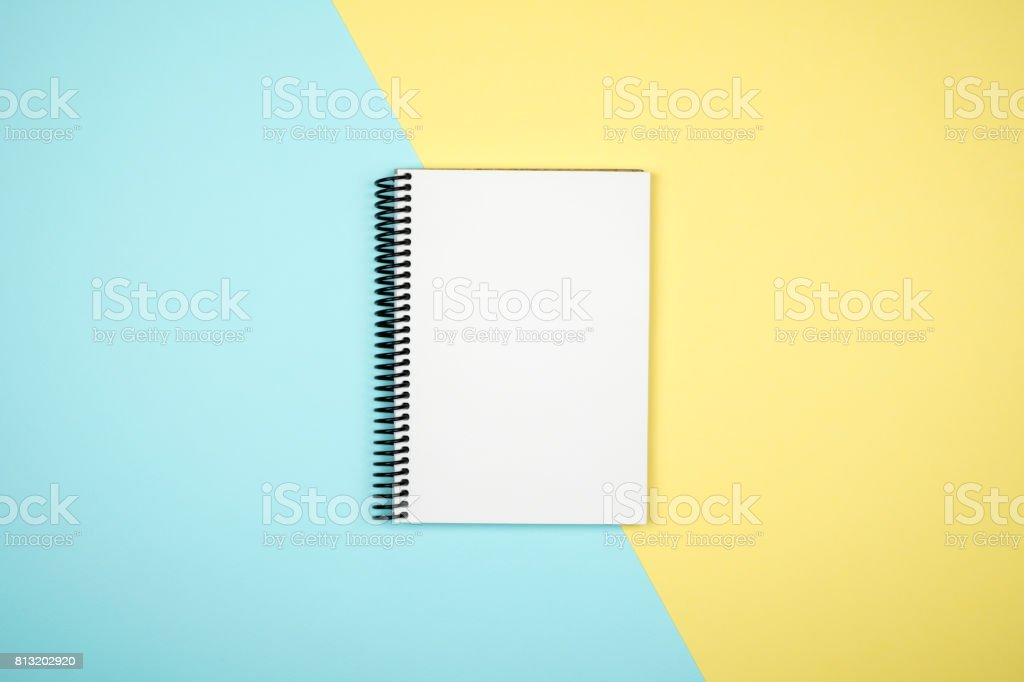 Blank writing pad for ideas and inspiration on colored background stock photo