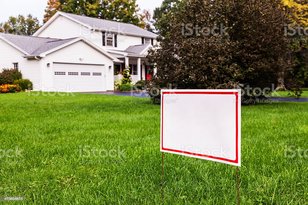 Blank Yard Sign On Suburban Home Front Lawn stock photo