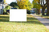 istock blank yard sign with copy space during fall 613040822