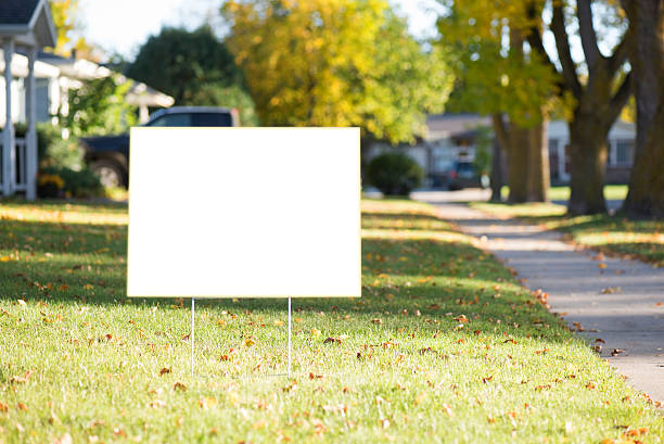 blank yard sign with copy space during fall white sign with clipping path on front lawn during sunny day. lawn stock pictures, royalty-free photos & images