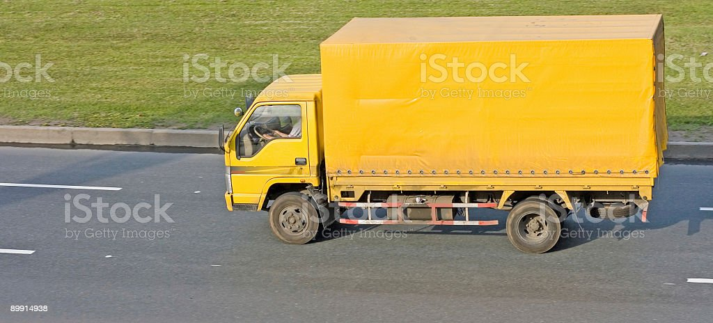 blank yellow big delivery truck on road royalty-free stock photo