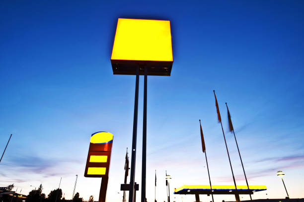 Blank Yellow Customizable Advertisement Board At in Gas Station stock photo
