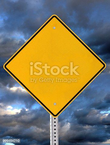 A vertical blank yellow danger warning sign with black border, with dark   weather storm clouds in the background.