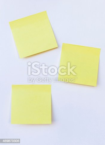 istock blank yellow note on isolated white background 459873305