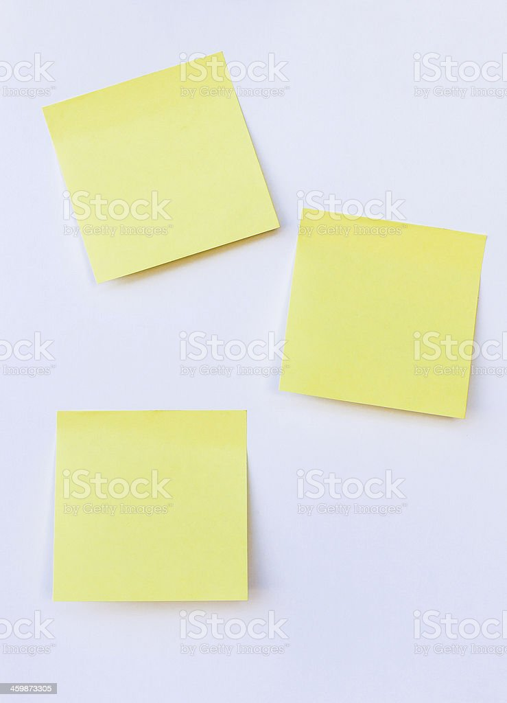 blank yellow note on isolated white background stock photo