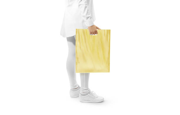 blank yellow plastic bag mockup holding hand - food logo stock photos and pictures
