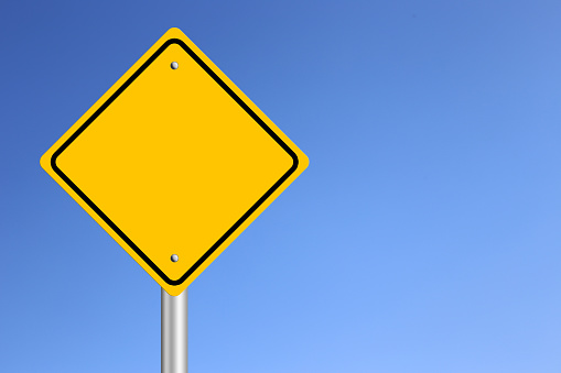 Blank Yellow  Road Sign with clear blue sky background.