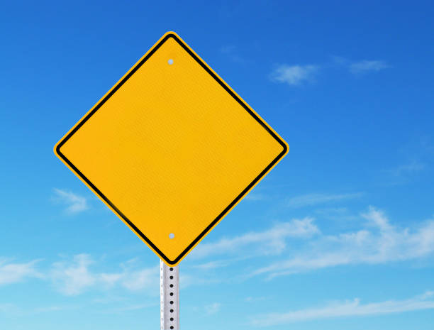 Blank Yellow Road Warning Information Sign Blue Sky Background stock photo