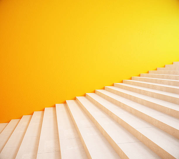 blank yellow wall and stairs - staircase stock photos and pictures