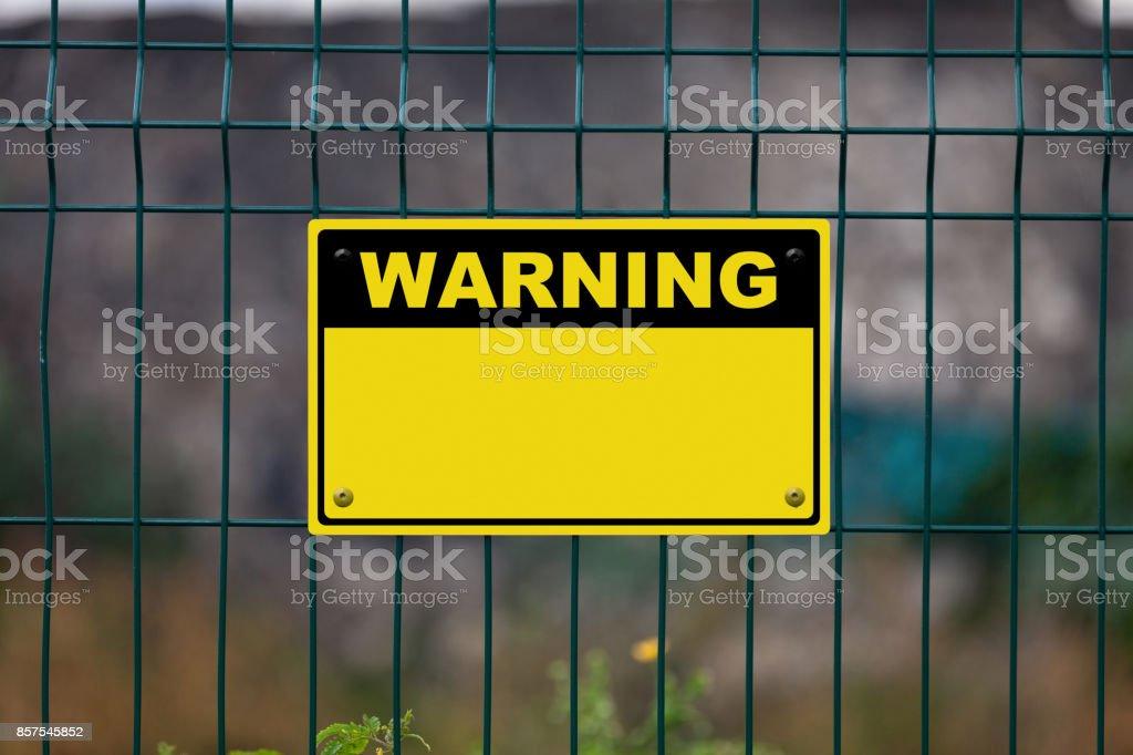 Blank yellow warning sign stock photo