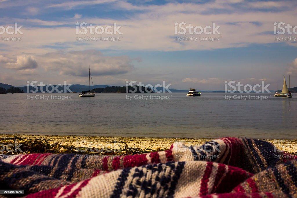 Blanket on the beach. stock photo