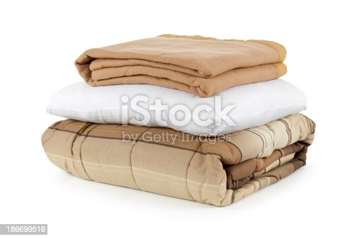 Blankets and a pillow, isolated on white.