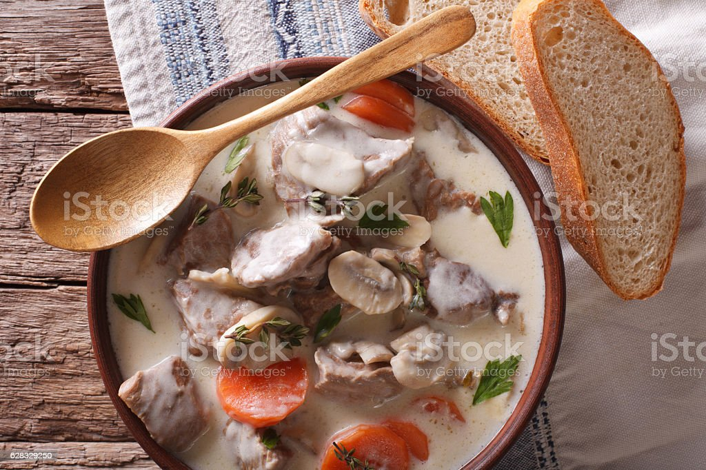 Blanquette de veau closeup in a bowl. horizontal top view - Photo