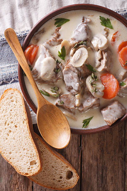 Blanquette of veal in a creamy sauce. vertical top view - Photo