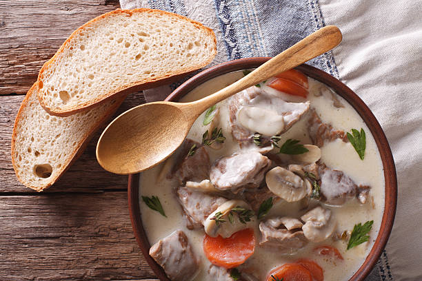 Blanquette of veal in creamy sauce in a bowl. Horizontal - Photo