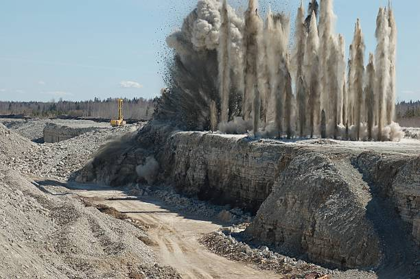 A blast that went off in an open pit  Blast of limestone in open cast mining quarry quarry stock pictures, royalty-free photos & images