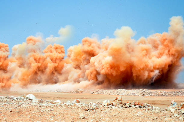 Blasting for rock breaking Detonator blasting on the construction site explosive stock pictures, royalty-free photos & images