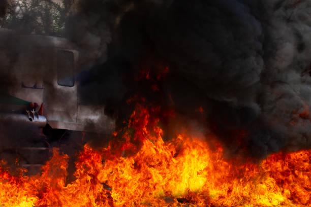 Blaze fire is burning with black smoke. stock photo
