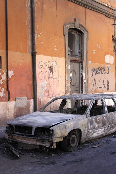 blazed car in rome - depredation stock pictures, royalty-free photos & images