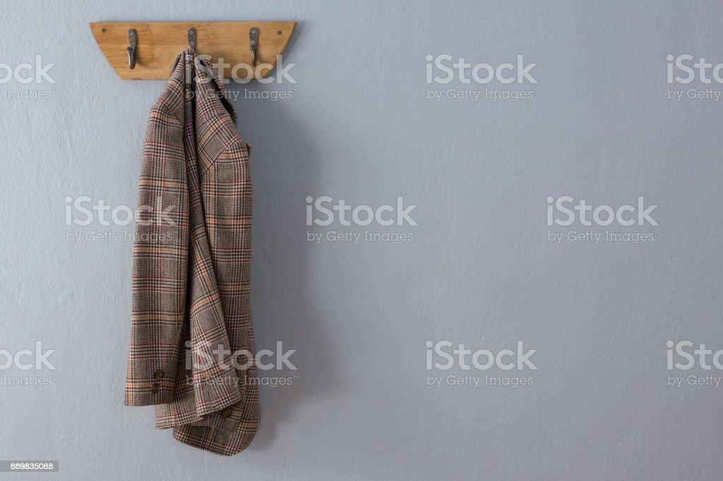 Blazer hanging on hook stock photo