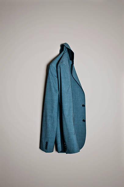 Blazer A grey blazer hanging. blazer jacket stock pictures, royalty-free photos & images