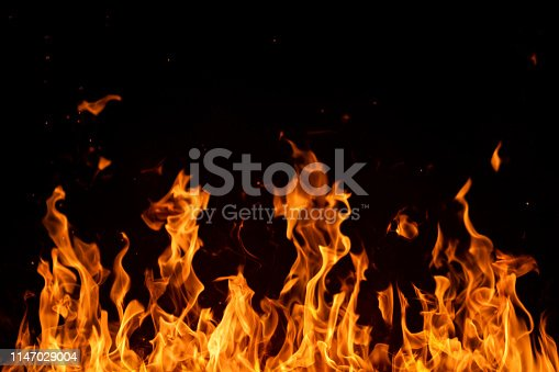 Blazing fire flames isolated on black