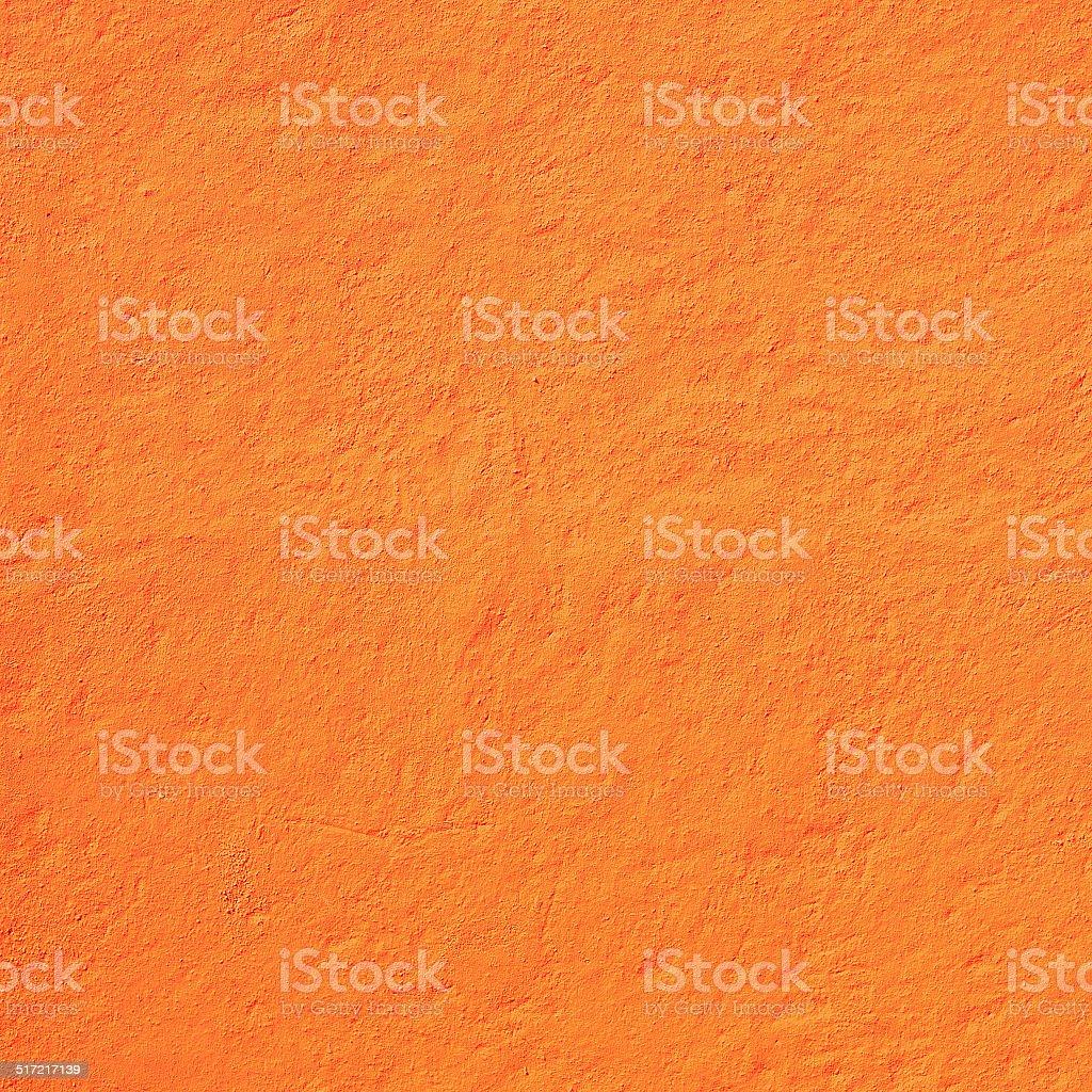Blazing orange rough wall stock photo